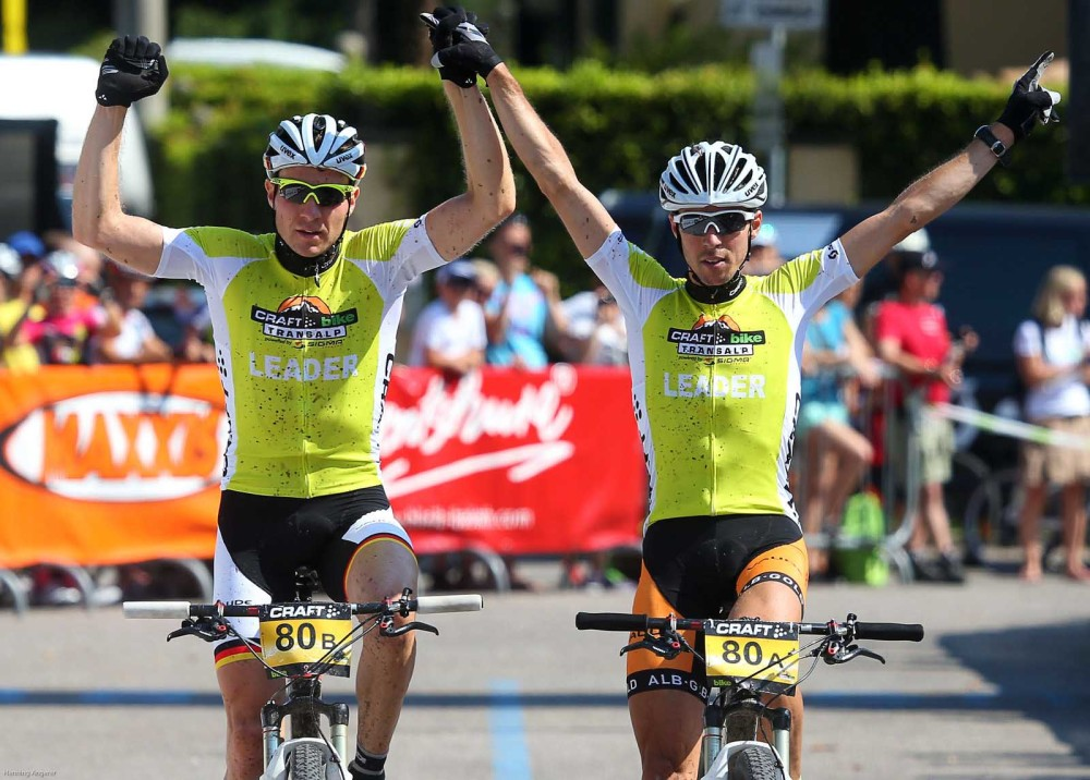 Transalp winners Markus Kaufmann (GER) and Jochen Kaess (GER)_Finish Craft BIKE transalp powered by Sigma 2013_Stage 8 Rovereto-Riva del Garda, 38.55km, 1,269 metres in elevation gain - (c) Henning Angerer/Craft BIKE Transalp